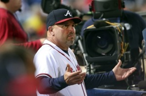 Atlanta Braves manager Fredi Gonzalez (33) argues from the dugout during a baseball game Toronto Blue Jays Wednesday, Sept. 16, 2015, in Atlanta. (AP Photo/John Bazemore)